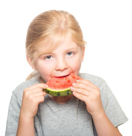 hazel eyes: Child with beautiful gray hazel eyes taking a big bite of watermelon isolated on white