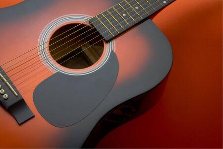 Acoustic guitar on orange background photo