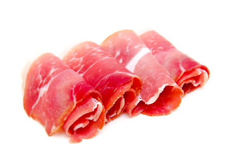 Slices of ham on white background Banque d'images