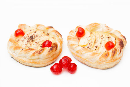 Puff pastry with apples on white background photo