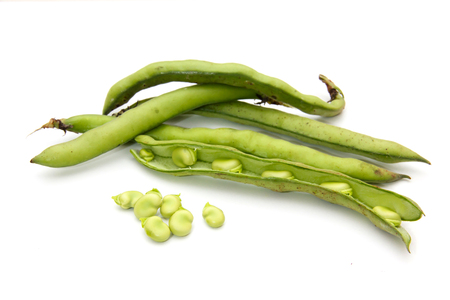 Fresh broad beans on a white