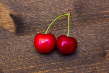Fresh cherries on a wooden floor  photo