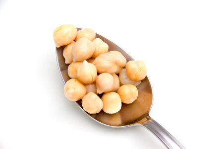 garbanzo bean: Chickpeas cooked on spoon on white background  Stock Photo