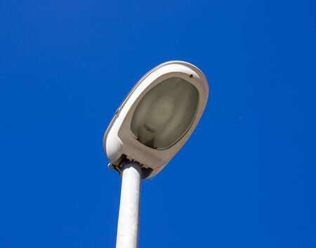 lighting column: Street lamp seen up close during the day