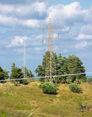 Electricity pylons placed between the trees  photo