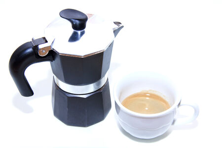Coffee maker with coffee cup on white background photo