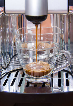 crema: Espresso coffee machine makes coffee while