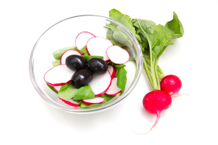l plate: Salad radishes in bowl on white background