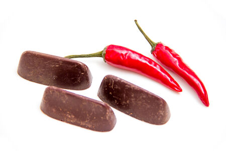 Chocolate with chilli seen up close on a white background photo