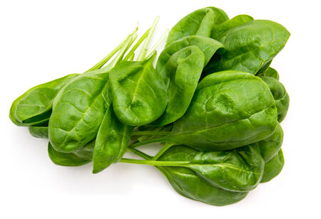Fresh spinach leaves on a white background seen from above