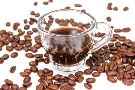 Cup of coffee and coffee beans on white background close up view photo