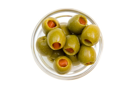 Stuffed olives on bowl on white background viewed from above Banque d'images