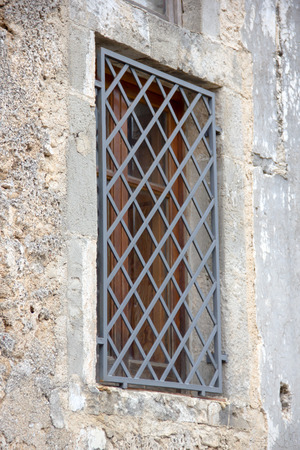 Rustic window with grates close up view Stock Photo