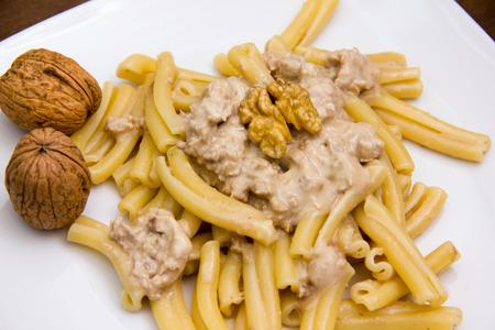 Pasta with walnut pesto close up view photo