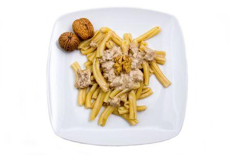 Pasta with walnut pesto on white background top view photo