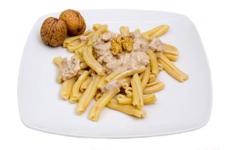 Pasta with walnut pesto on white background photo