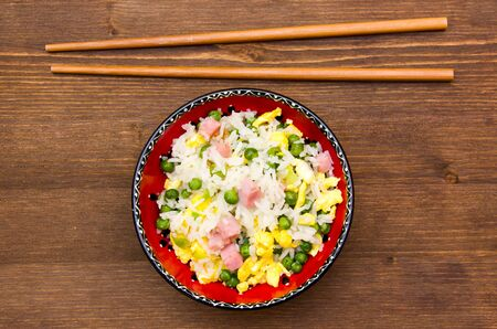 cantonese: Cantonese rice on wooden table seen from above Stock Photo