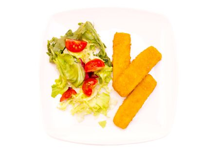 fishfinger: Fish fingers with salad on white background seen from above Stock Photo