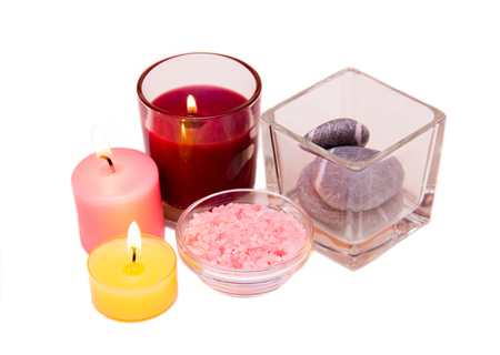 perfumed candle: Candles and bath salts on white background
