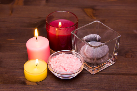 perfumed candle: Candles and bath salts on wooden table Stock Photo