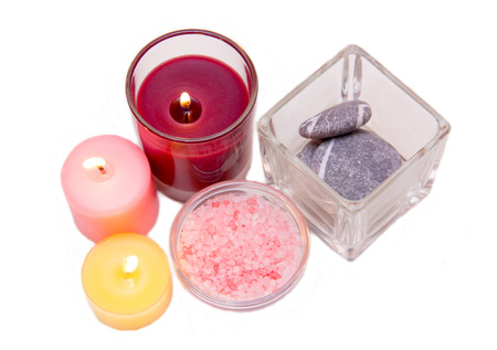 perfumed candle: Candles and bath salts on white background seen from above