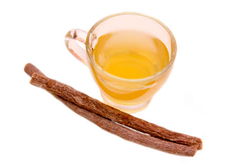 licorice: Herbal tea licorice in cup on white background top view Stock Photo