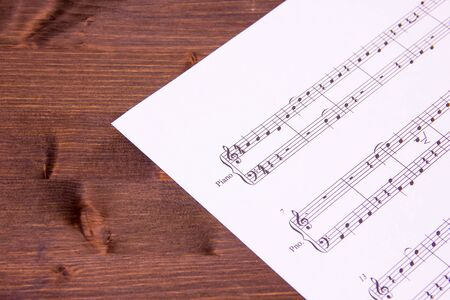 minuet: Sheet music for piano on a wooden table Stock Photo