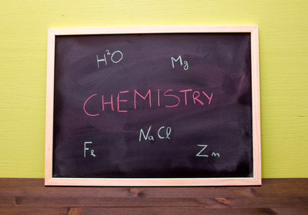 chemistry lesson: Blackboard with chemistry lesson on green wall