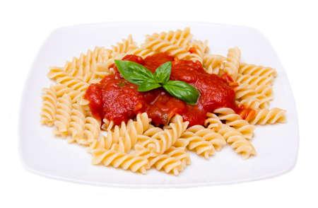 fusilli: Fusilli with tomato sauce on white background