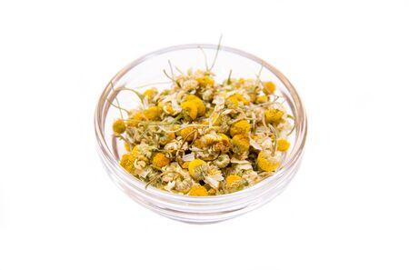 chamomile flower: Chamomile flower on bowl on a white background