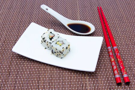 california roll: California roll with avocado and surimi on bamboo placemat Stock Photo