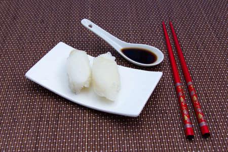 halibut: Nigiri with halibut on a bamboo mat