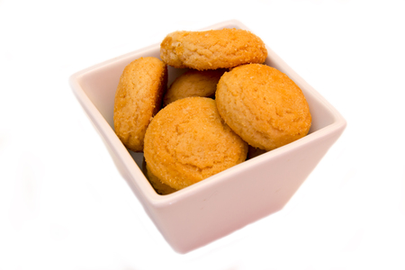 Stuffed biscuits on square bowl on a white background