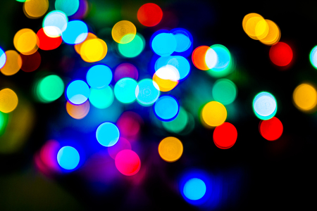 Bokeh of colored lights on a dark background