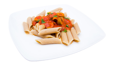 Pasta with tomato sauce and olives on a white background