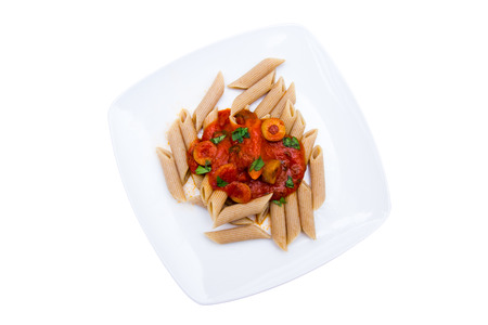 Pasta with tomato sauce and olives on a white background top view