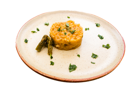Risotto with cream of asparagus on a white background 免版税图像