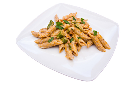 Pasta with asparagus and cream on a white background