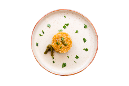 Risotto with cream of asparagus on a white background seen from above 免版税图像