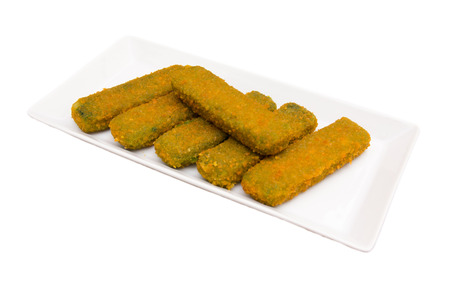 Spinach sticks on a tray on a white background