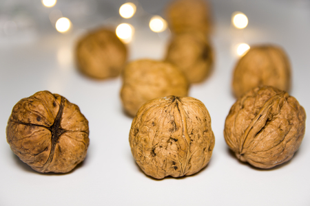 Walnuts on a white background with blurred lights Banque d'images