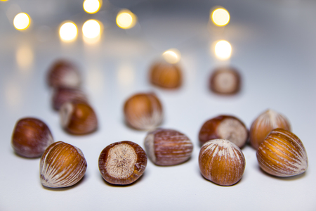 Hazelnuts on a white background with blurred lights in the background 免版税图像
