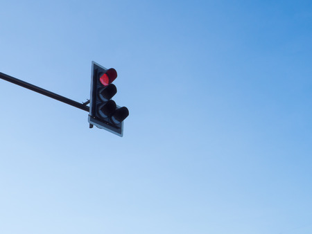 Traffic light red with blue sky background