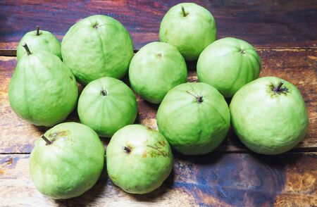 Guava green on wood table