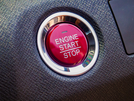 Engine car starts or stops button on modern car Imagens