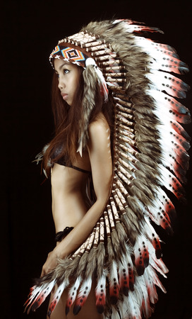 Native american, Indians in traditional dress, standing in profile, American indian Girl, black background Stock Photo