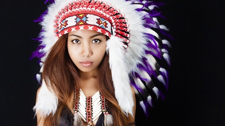 Native american, Indians in traditional dress, standing in profile, American indian Girl, black background photo