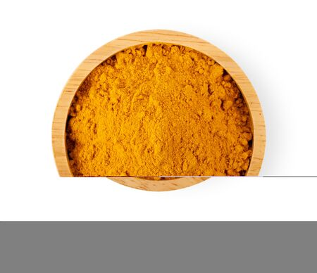 Turmeric powder in wood bowl isolated on white background Stock Photo