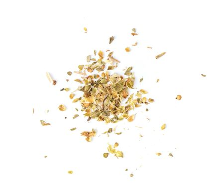 Pile of dried oregano leaves on a white background. top view