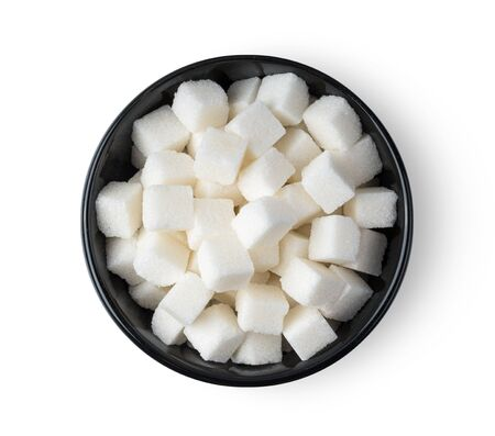 Sugar cube in black bowl isolated on white background. top view